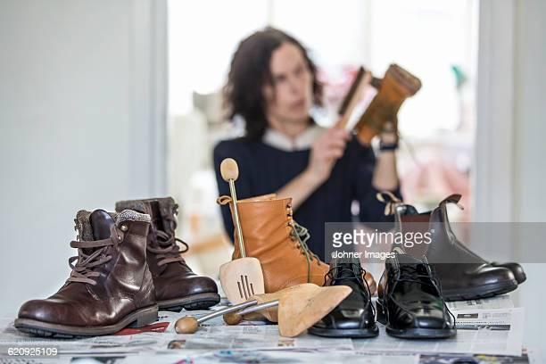 Woman polishing shoes