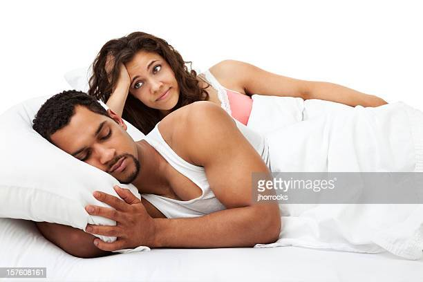 woman ponders waking husband up - black man sleeping in bed stock pictures, royalty-free photos & images