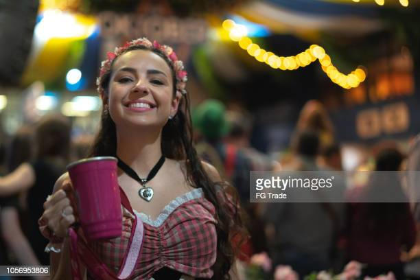 woman portrait at oktoberfest - northern european descent stock pictures, royalty-free photos & images