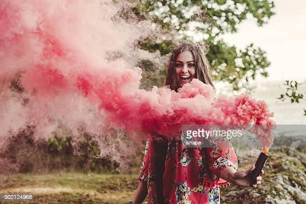 Woman portrait in red smoke
