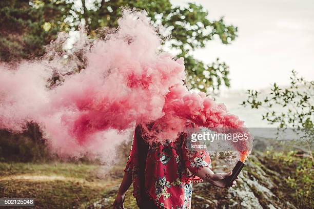 Woman portrait in red smoke