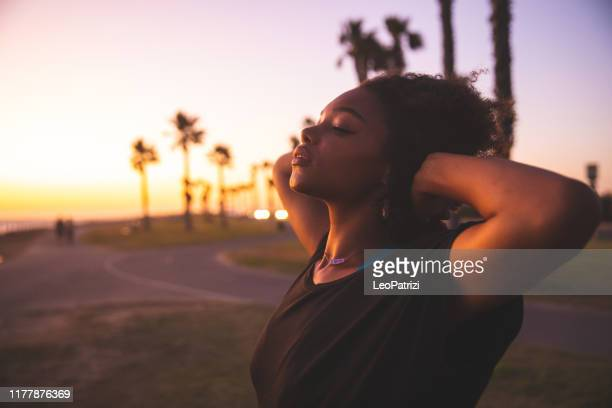 woman portrait on the beach in southern california - hope stock pictures, royalty-free photos & images