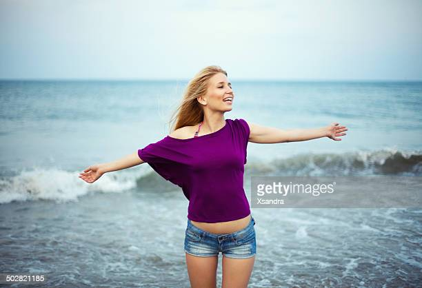 woman portrait - purple shirt stock photos and pictures