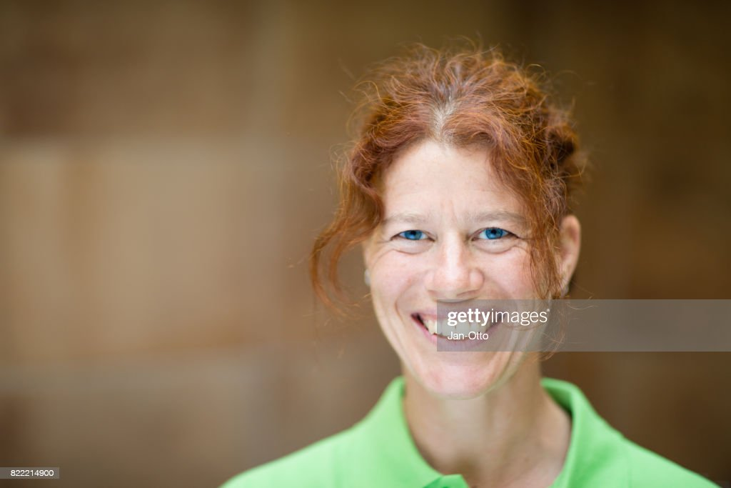 Woman portrait, smiling into camera : Stock Photo
