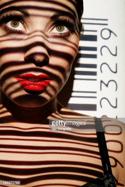 Woman portrait with projected bar code as a symbolic image for biometrics
