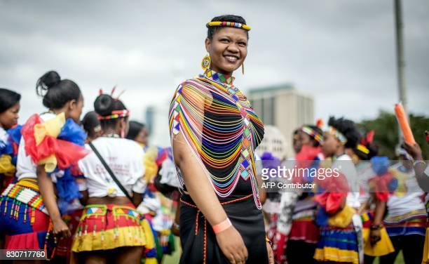 TOPSHOT A woman poses as hundreds of young traditionallyclad maidens take part in the South African Traditional Music Awards cultural parade on...