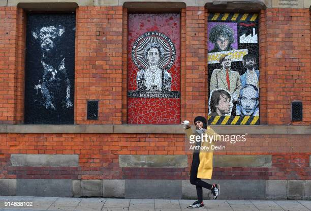 A woman poses beneath a mosiac of Emmeline Pankhurst outside Affleck's Palace in the Northern Quarter on February 6 2018 in Manchester England On...