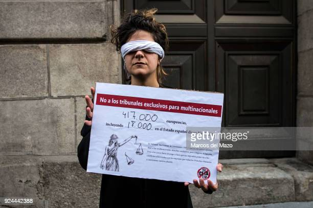 A woman poses during a performance carried out in front of the Ministry of Finance where activists have delivered 417k European signatures against...