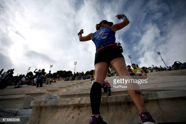 A woman poses during the 35th Athens Classic Marathon in Athens Greece November 12 2017