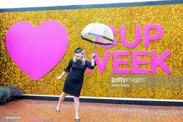 A woman poses for a photo at a cup week feature wall during 2019 Derby Day at Flemington Racecourse on November 2 2019 in Melbourne Australia