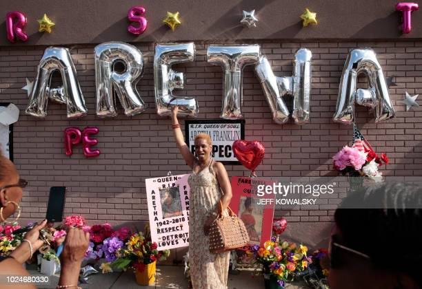 TOPSHOT A woman poses for a photo at the Aretha Franklin tribute service at the New Bethel Baptist Church on August 27 2018 in Detroit Michigan...