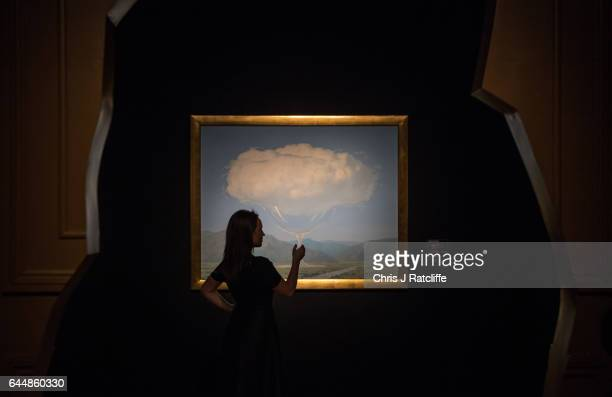 A woman poses for a photo in front of 'La corde sensible' by Rene Magritte estimated at £14£18 million at Christies on February 24 2017 in London...