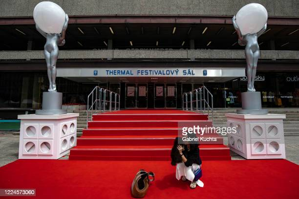 Woman poses for a photo on a red carpet set in front of the Thermal movie theater on July 03, 2020 in Karlovy Vary, Czech Republic. The 55th Karlovy...