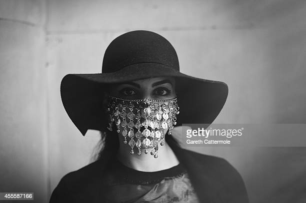 A woman poses for a photograph during London Fashion Week Spring Summer 2015 at Somerset House on September 13 2014 in London England
