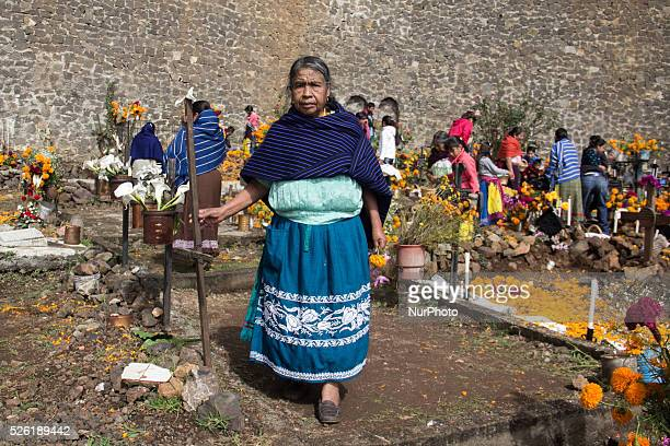 A woman poses for a photograph in the cemetery of Janitzio on November 1 2015