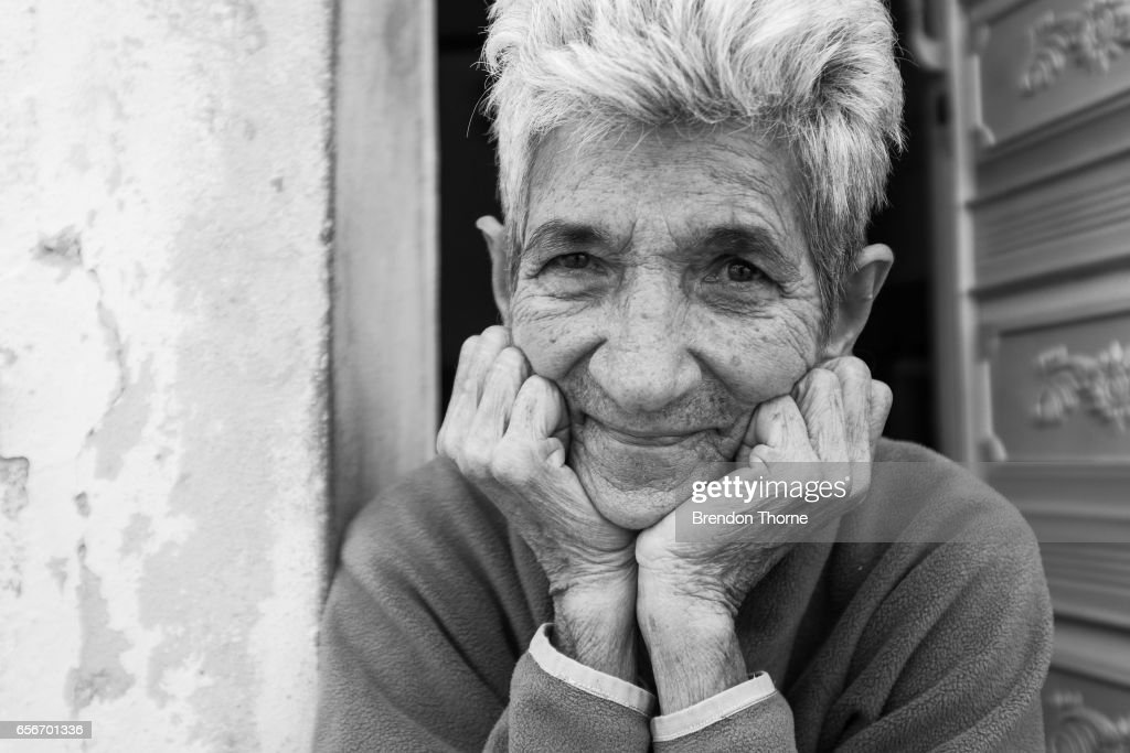 A woman poses for a photograph on February 2, 2017 in Matanzas, Cuba.