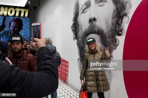 A woman poses for a picture inside the 'Jova Pop Store' on December 1 2017 in Milan Italy Italian singer and songwriter Jovanotti opened a temporary...