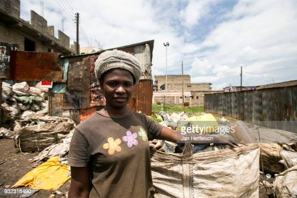 A woman poses for a picture near the Dandora rubbish dump on March 14 2018 in Nairobi Kenya The Dandora landfield is located 8 Kilometer east of the...