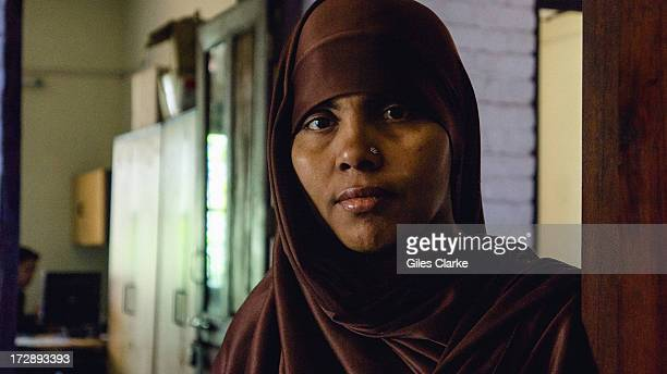 A woman poses for a portrait at the Sambhavna Clinic where 47000 adult patients receive free treatment November 30 2012 in Bhopal India On the night...