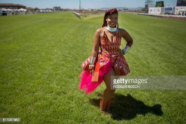 A woman poses for photos before the start of the Met horse race at Kenilworth race track on January 27 in Cape Town The Met is one of South Africa's...