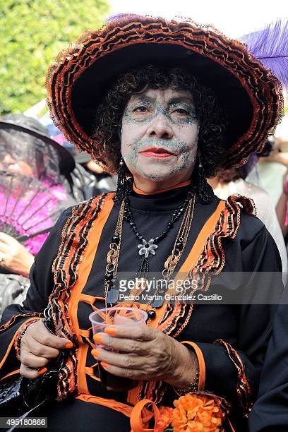 A woman poses for pictures during the Catrinas contest as part of Day of the Dead celebration on October 31 2015 in Morelia Mexico