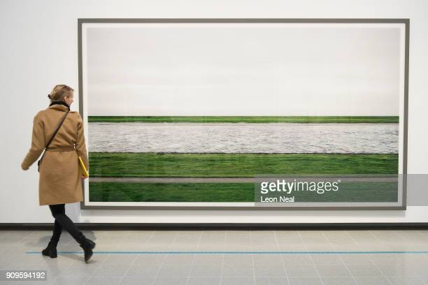 A woman poses in front of 'Rhine II' by Andreas Gursky in the reopened Hayward Gallery on January 24 2018 in London England Following a twoyear...