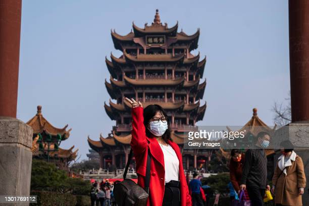 Woman poses in the Yellow Crane Tower Park during the first day of the Spring Festival on February 12, 2021 in Wuhan, Hubei Province, China. China is...