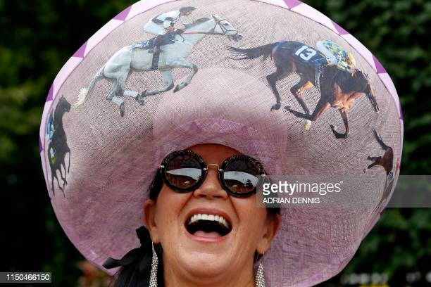 TOPSHOT A woman poses on day one of the Royal Ascot horse racing meet in Ascot west of London on June 18 2019 The fiveday meeting is one of the...