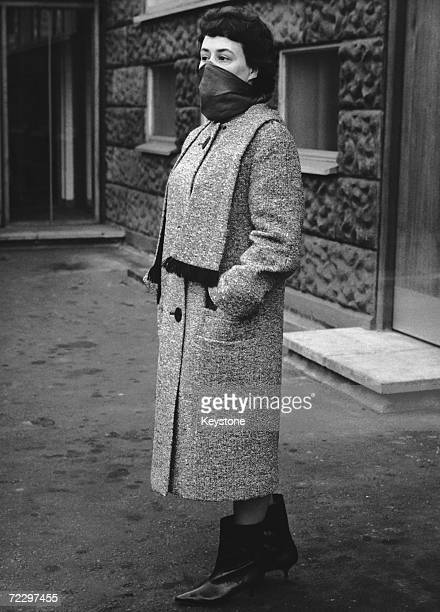 A woman poses outside Shepherd's Bush police station wearing clothes identical to those of murder victim Bridget or Bridie O'Hara in an attempt to...
