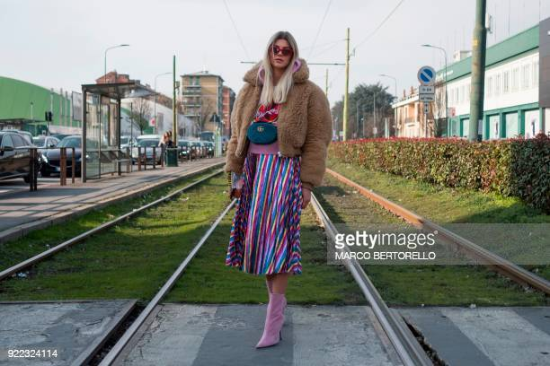 A woman poses prior to the women's Fall/Winter 2018/2019 collection fashion show by Gucci in Milan on February 21 2018 / AFP PHOTO / Marco BERTORELLO