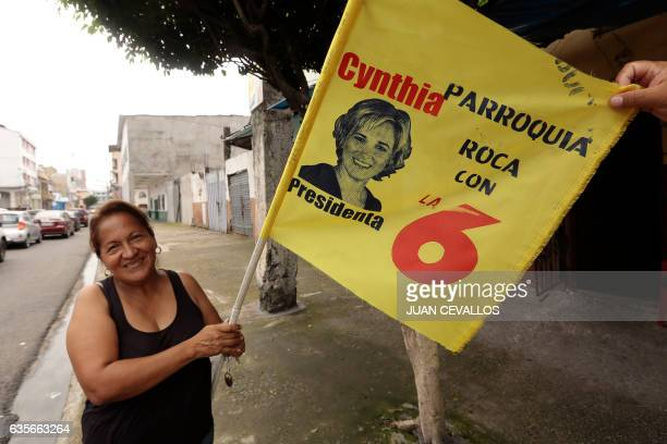 A woman poses with a propaganda flag of Ecuadorean presidential candidate for the Social Christian party Cynthia Viteri in Guayaquil Ecuador on...