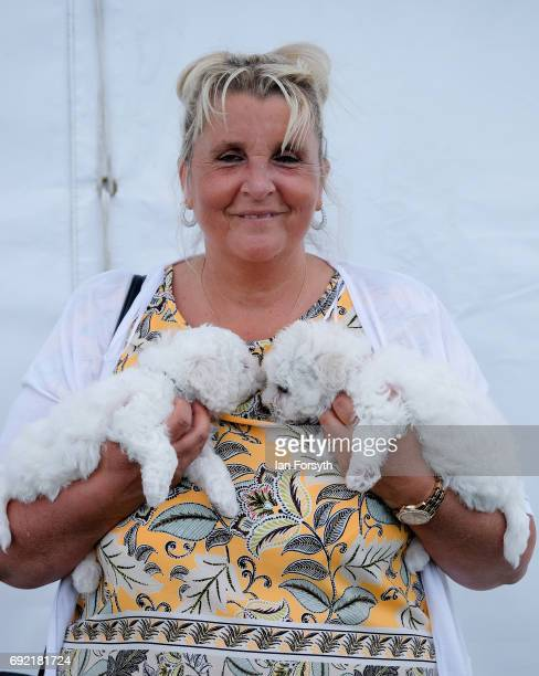 Woman poses with her dogs as she joins other owners to take part in the Great North Dog Walk on June 4, 2017 in South Shields, England. Founded in...