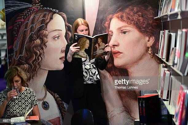 A woman poses with the book 'Dialog der Meisterwerke' at the 2015 Frankfurt Book Fair on October 15 2015 in Frankfurt am Main Germany The 2015 fair...