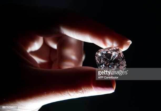 A woman poses with the 'Le Grand Mazarin' a 1907 carat pink diamond at Christie's auction house in London on October 17 2017 'Le Grand Mazarin' is...