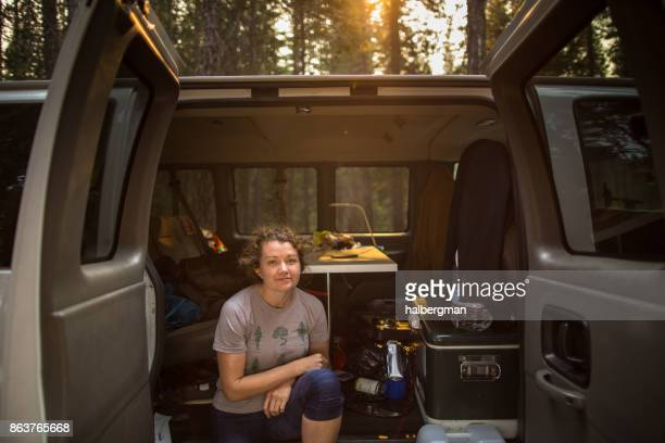 Woman Posing by Camper Van