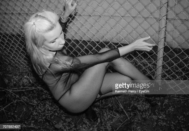 Woman Posing By Fence
