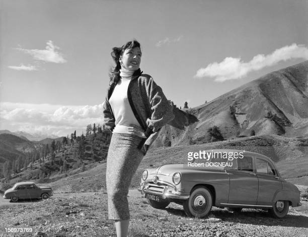 Woman posing for advertising for the Simca Aronde at the Col d'Izoard, 1953 in Col d Izoard, France.