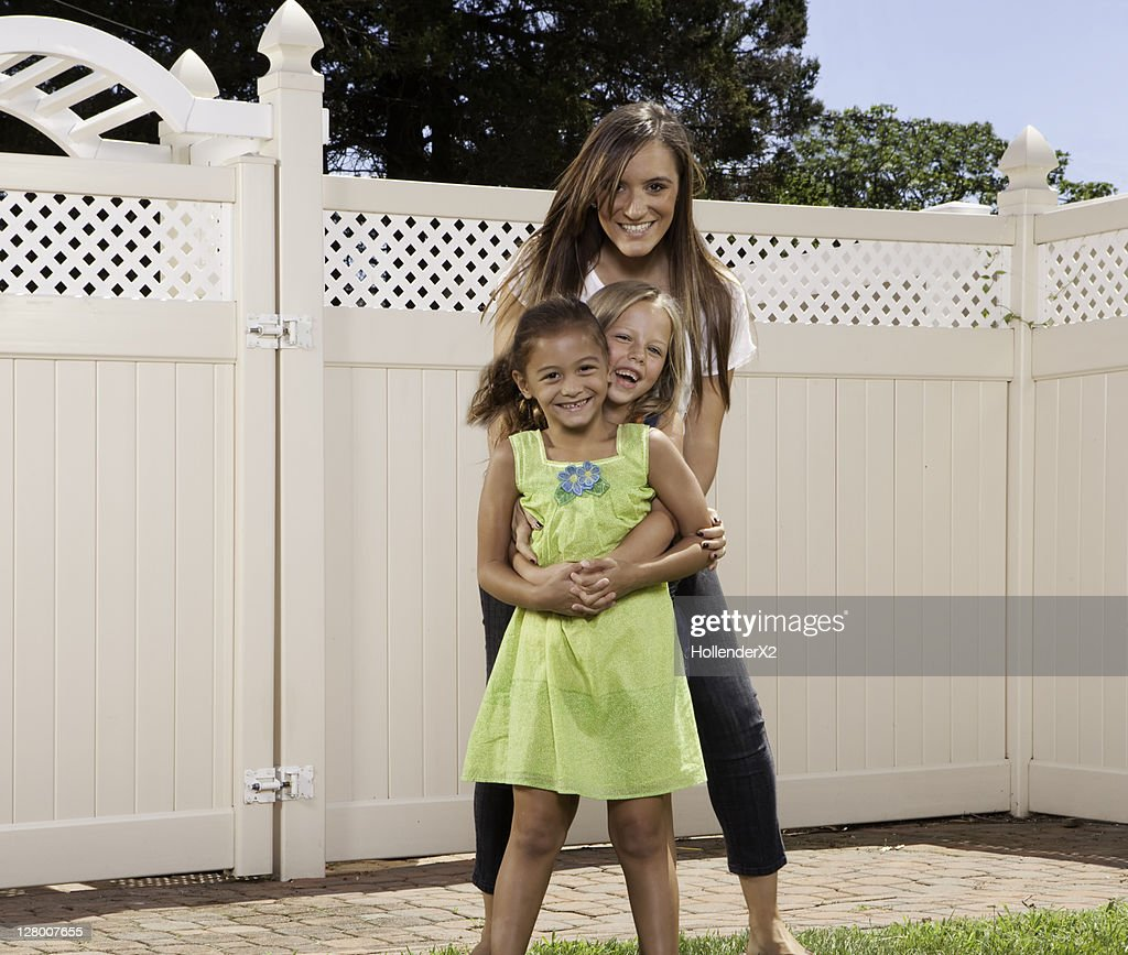 Woman Posing For Photo With 2 Girls Stock