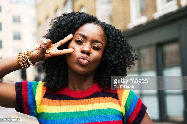 woman posing for social media. - showing off stock pictures, royalty-free photos & images