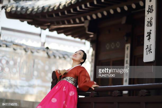 woman posing in a traditional Korean outfit