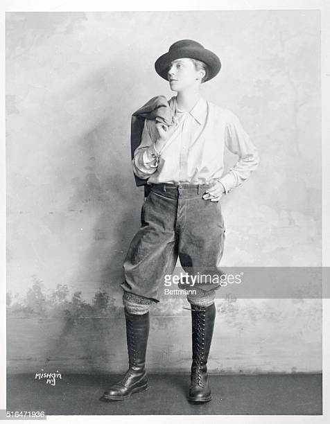 Woman posing in curdoroy knickers knee high boots and brimmed hat