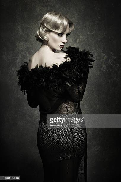 woman posing in feather boa - retro style