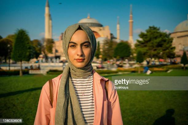 woman posing in front of hagia sophia - turkey middle east stock pictures, royalty-free photos & images