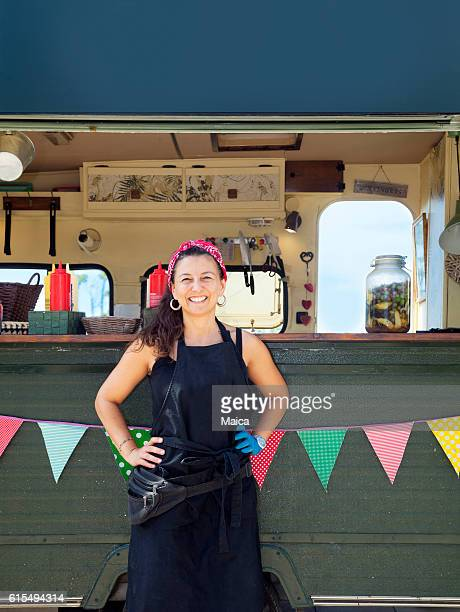 Woman posing in front of her food truck