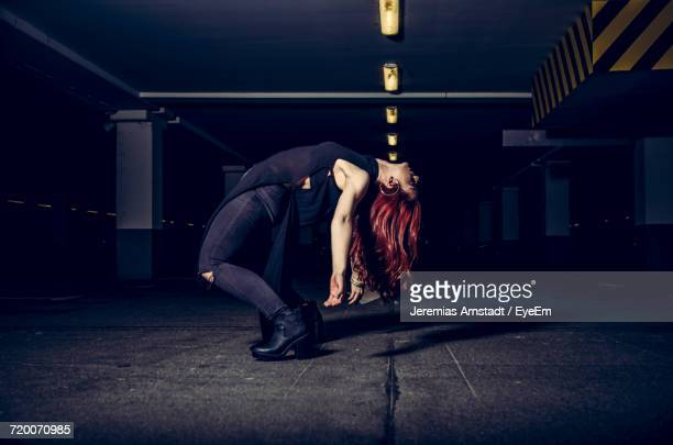 woman posing in parking lot - bending over backwards stock photos and pictures