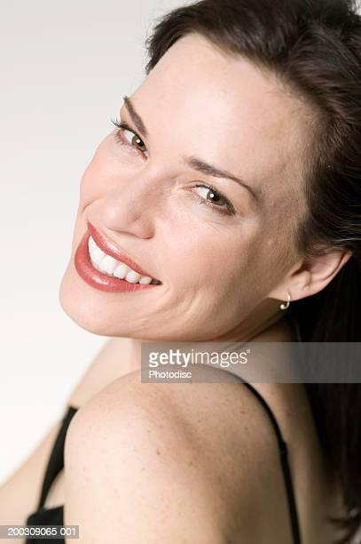 Woman posing in studio, portrait
