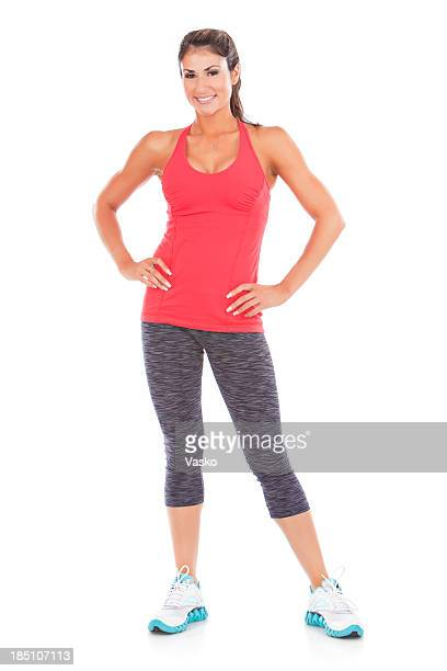 Woman posing in workout clothes with hands on hips
