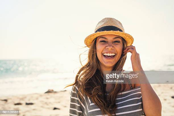 woman posing on beach - hat stock pictures, royalty-free photos & images