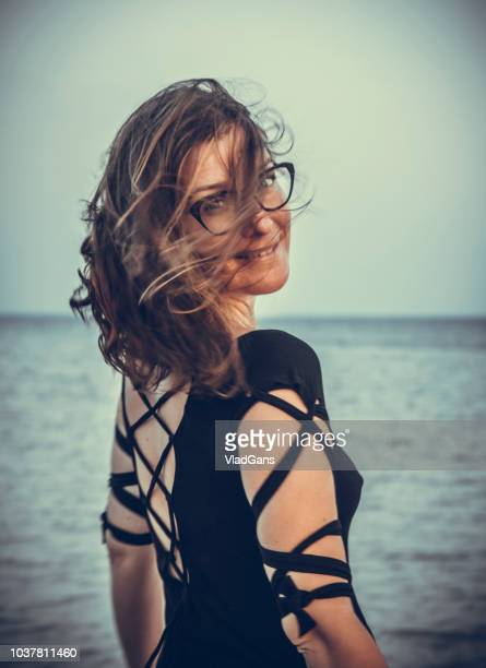 woman posing on sunset background - vlad models stock pictures, royalty-free photos & images