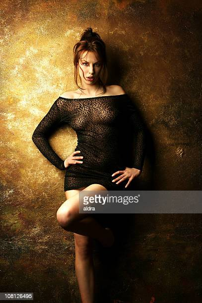 woman posing wearing sheer see-through shirt - women in see through dresses stock photos and pictures